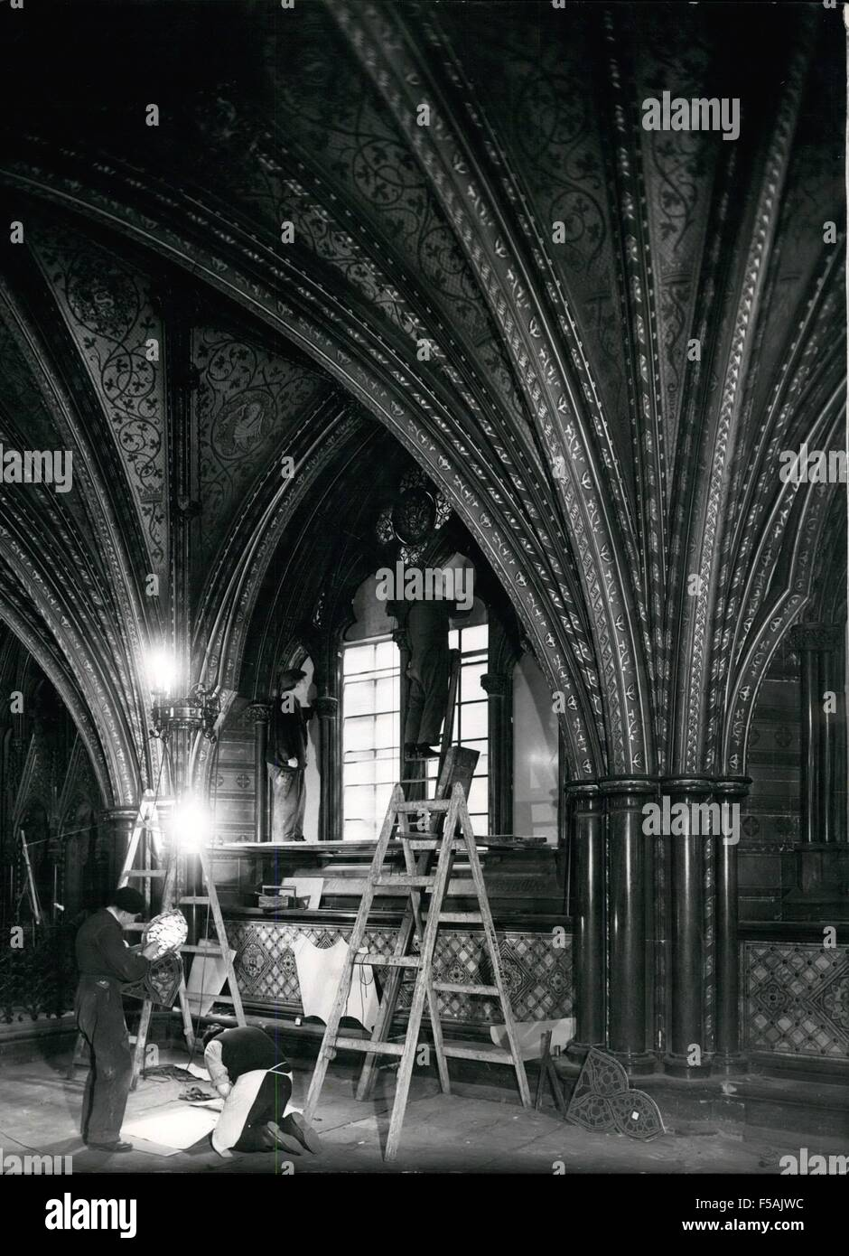 1968 - Work in the Crypt Below St. Stephan's. Workmen are putting ply-wood patterns into position in he windows, - Stock Image