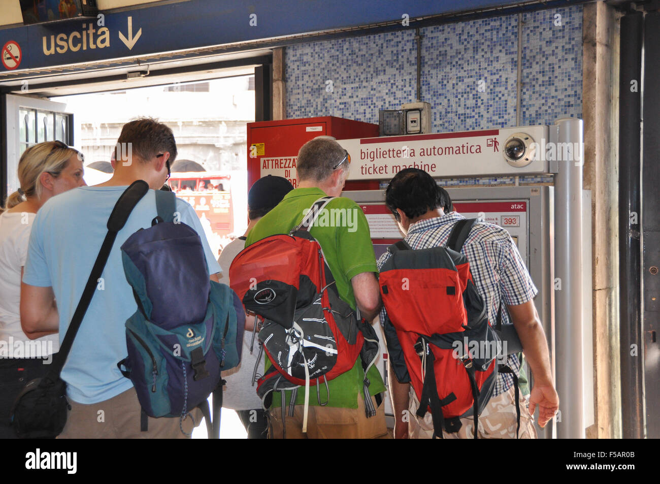 Rome metro - Tourists of different nationalities trying to use the ticket machine in the Rome metro underground - Stock Image