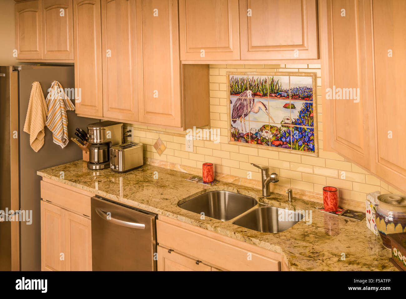 Remodeled kitchen with granite countertop and tile backsplash Stock Photo