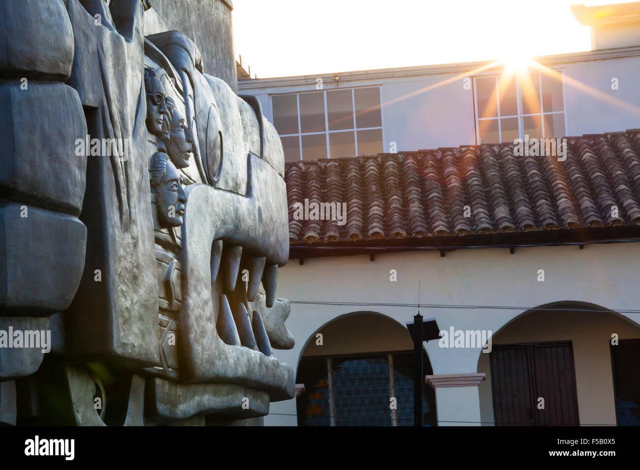 Last rays of sun reflect off the large Totonac relief near the plaza of Papantla, Veracruz, Mexico. - Stock Image
