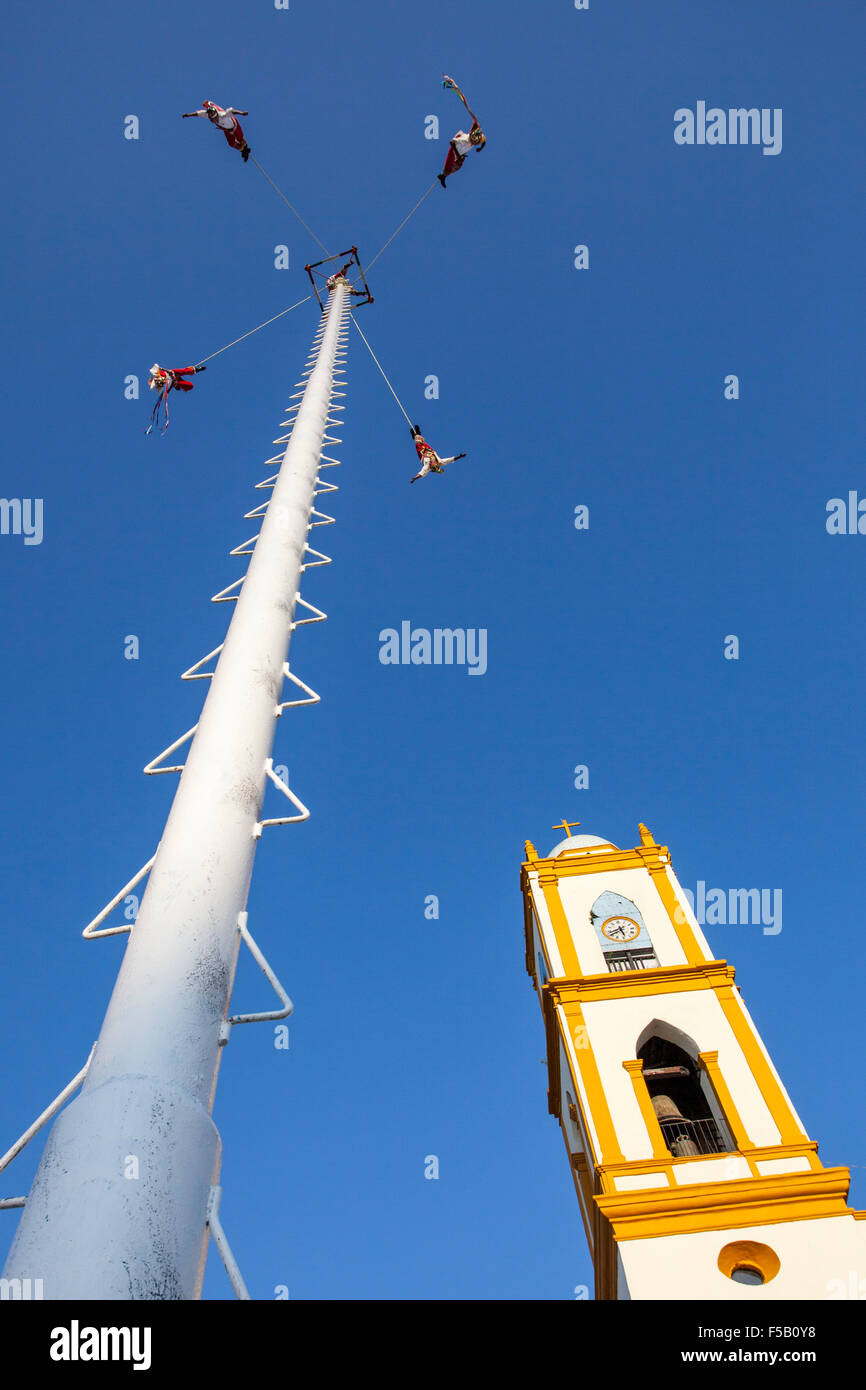 Papantla voladores or flyers swing around the post during an Totonac ritual performed  in Papantla, Veracruz, Mexico. - Stock Image