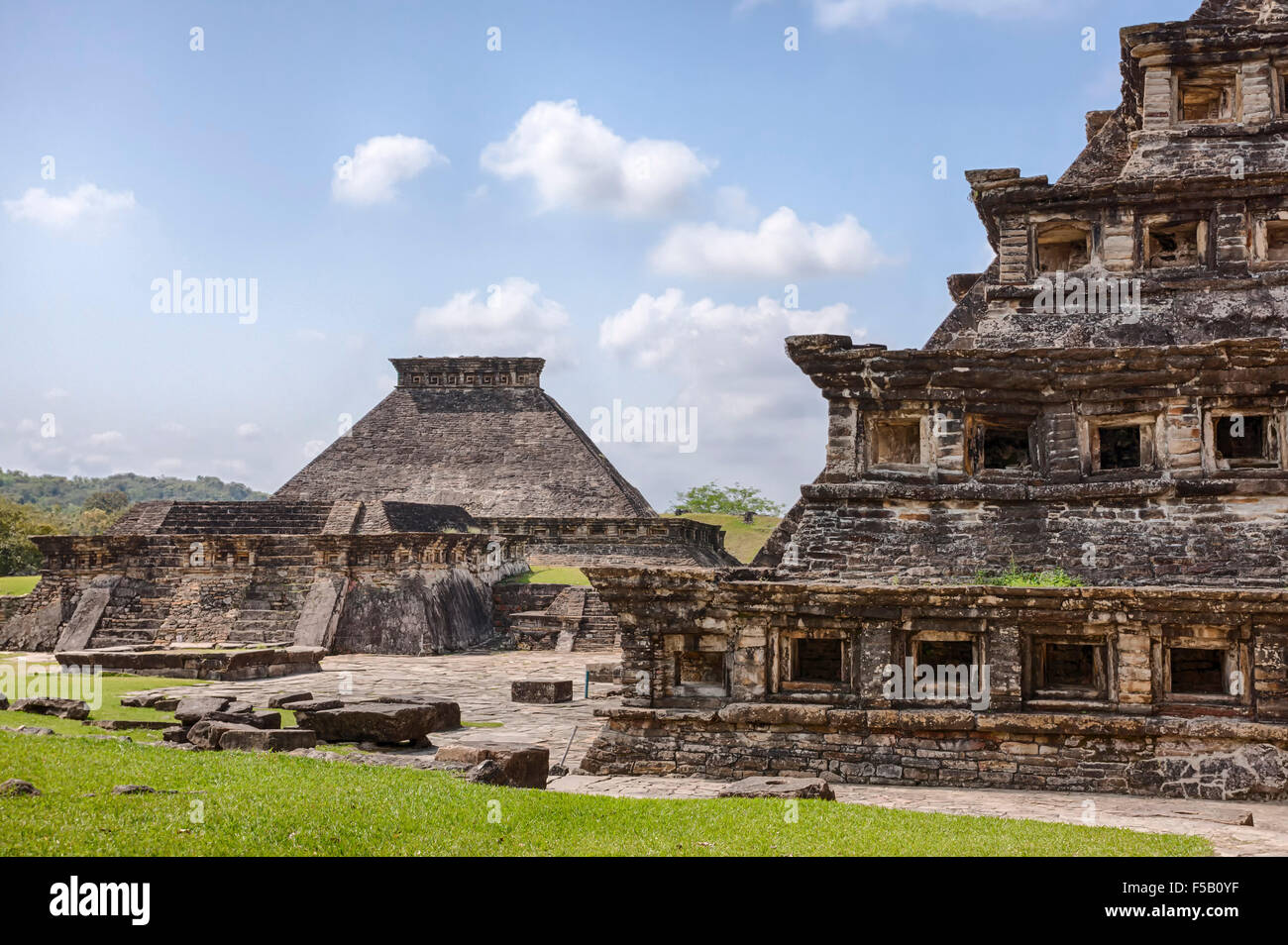 Building 5 in the distance and the Niches Pyramid at the Tajin, Veracruz ruins in Mexico. - Stock Image