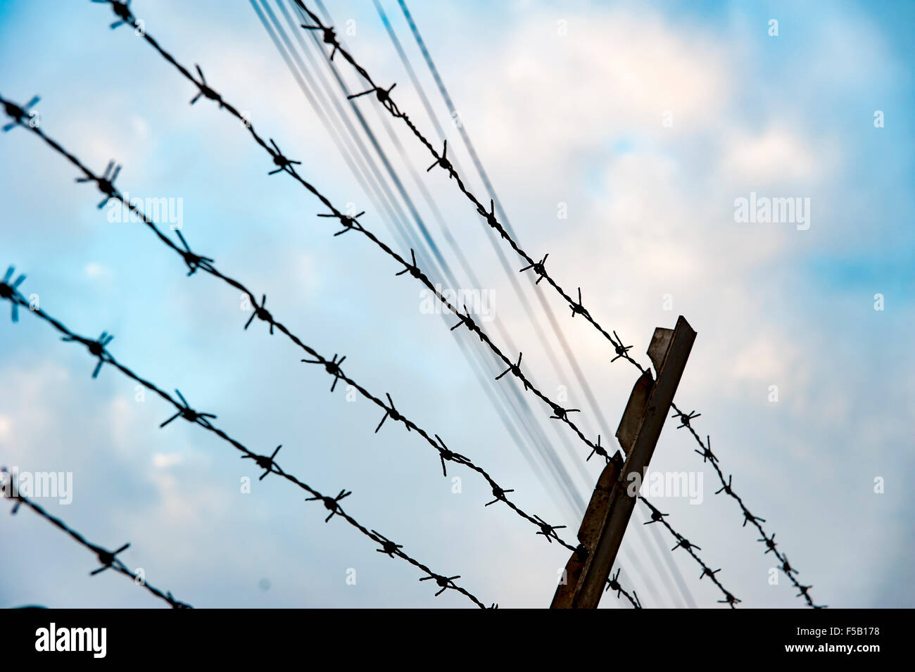 Metal fence with spike pointing to the sky - Stock Image