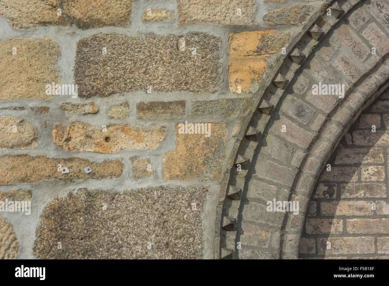 Section of brickwork and stone arch detail on a house in