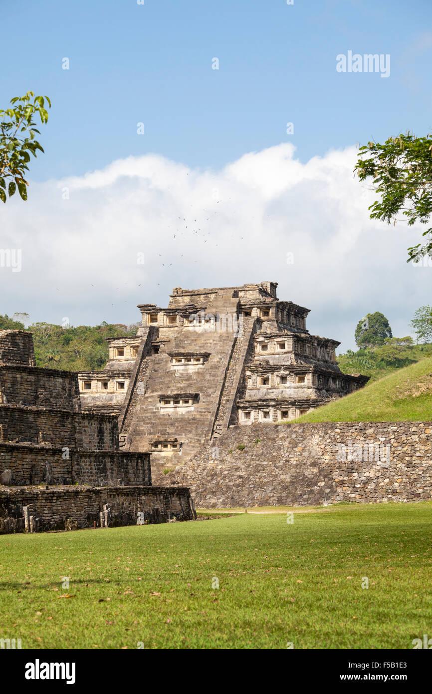 Birds hover near the Niches Pyramid at the Tajin ruins in Veracruz, Mexico. - Stock Image