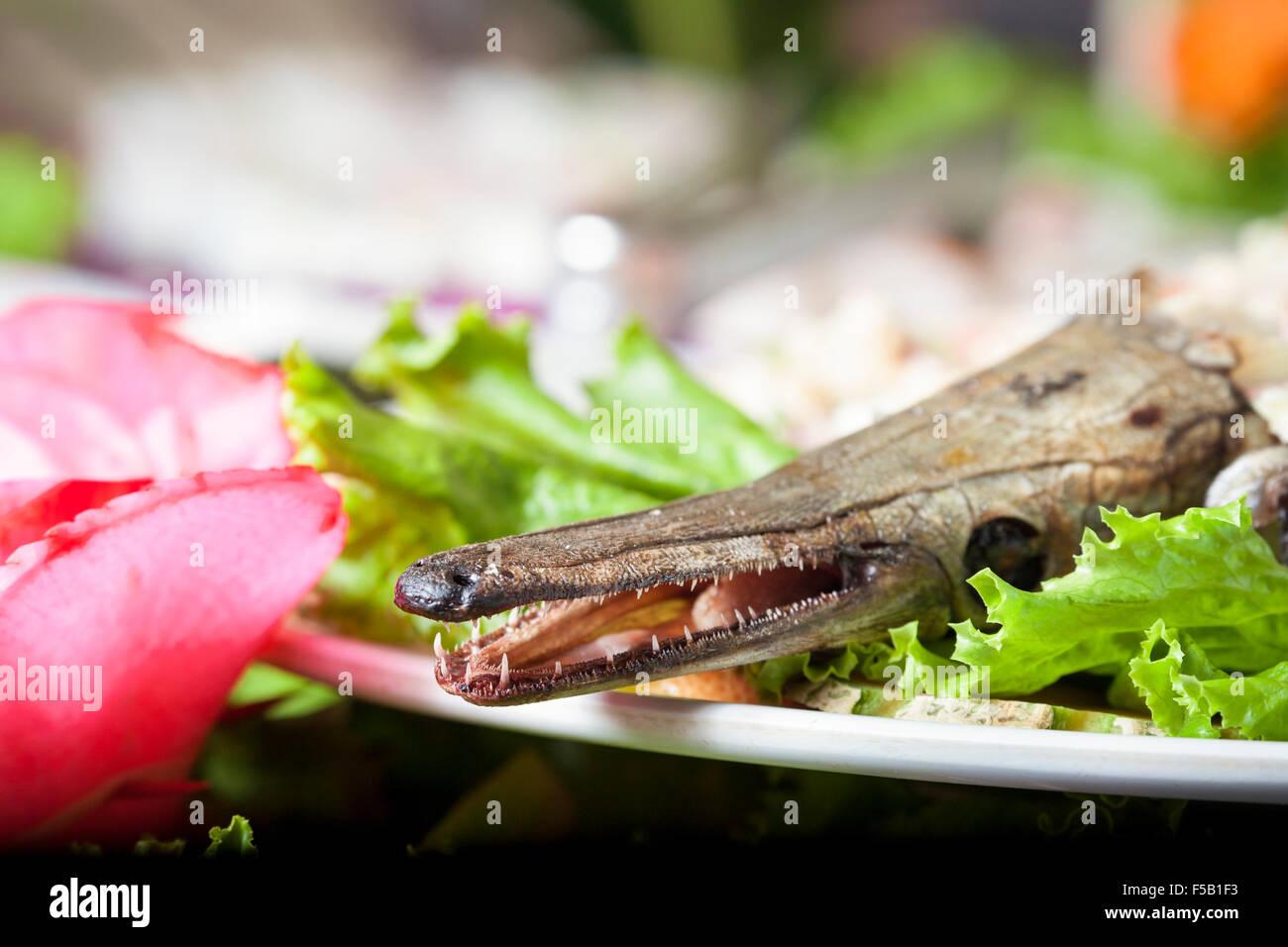 A local specialty, pejelagarto or freshwater gar, in a Villahermosa, Tabasco, Mexico seafood restaurant. - Stock Image