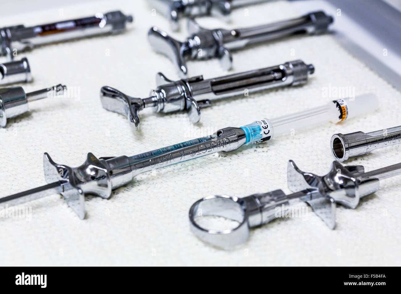 Dentist office, dental instruments,  dental treatment, prevention, examination, check up, syringe, injection, anaesthetic - Stock Image