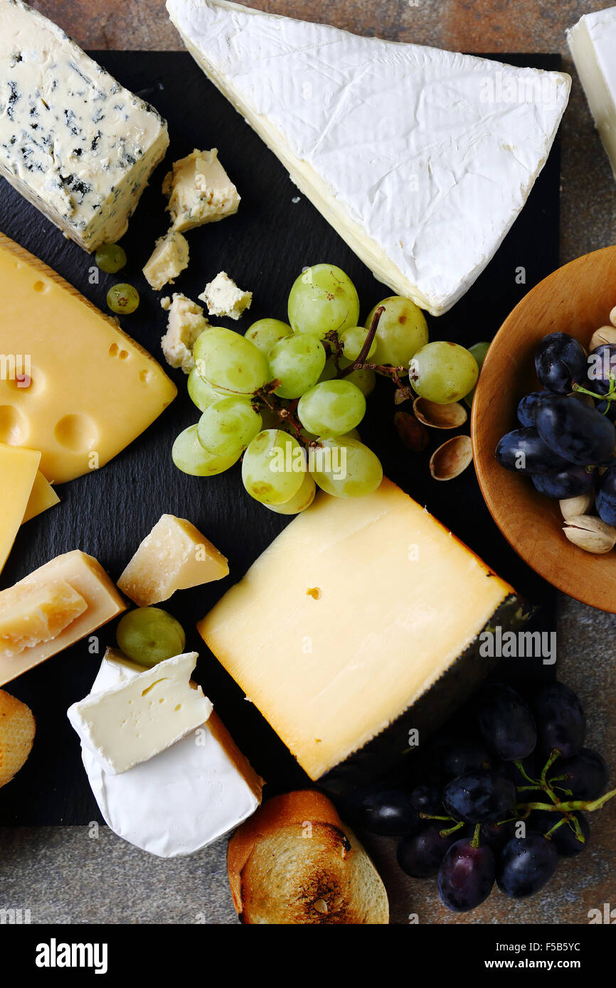 mix cheeses and fruits, food top view - Stock Image