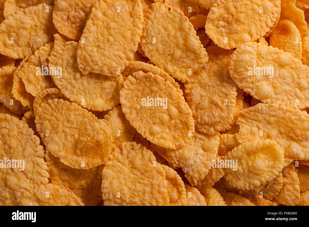 Food background made of many corn flakes - Stock Image