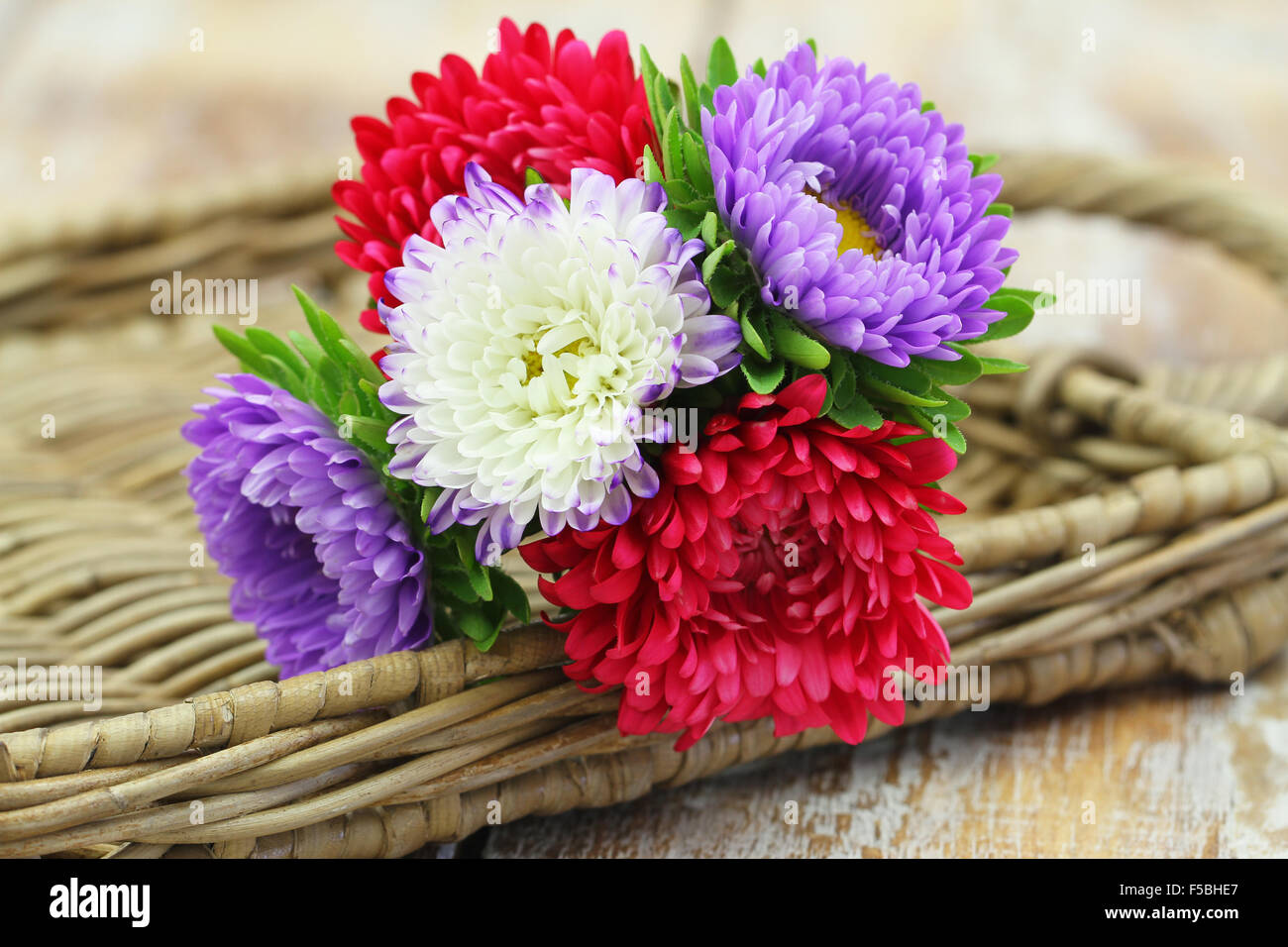 Colorful aster flower bouquet on wicker tray with copy space Stock ...