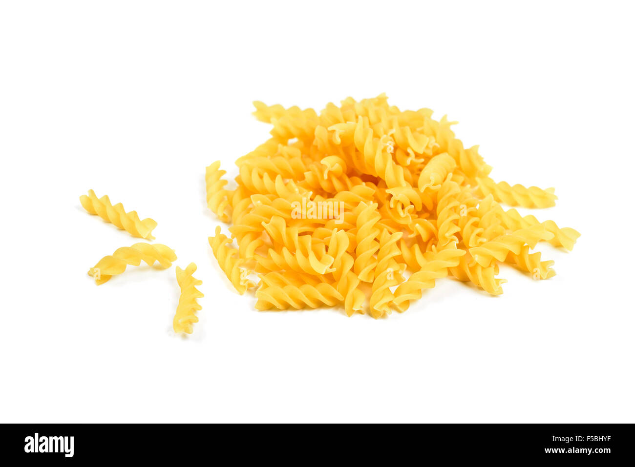 Rotini pasta heap and alone on white background - Stock Image