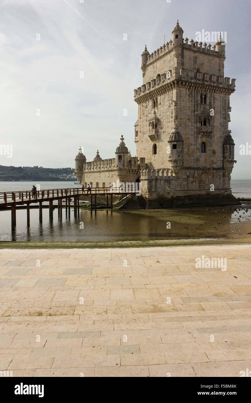 LISBON, PORTUGAL - OCTOBER 24 2014: Belem Tower of Lisbon, Unesco world heritage, with people on the bridge - Stock Image