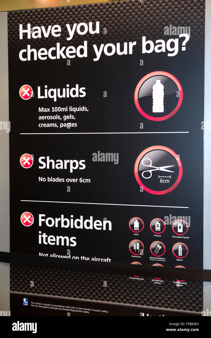 Warning sign showing prohibited & banned items at security check – at passenger check-in – at London Heathrow - Stock Image