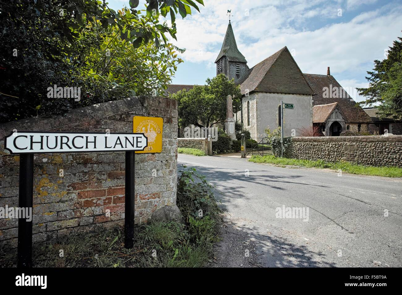 Church Lane, Northney, Hayling Island with the 12th century St Peter's church in the background - Stock Image