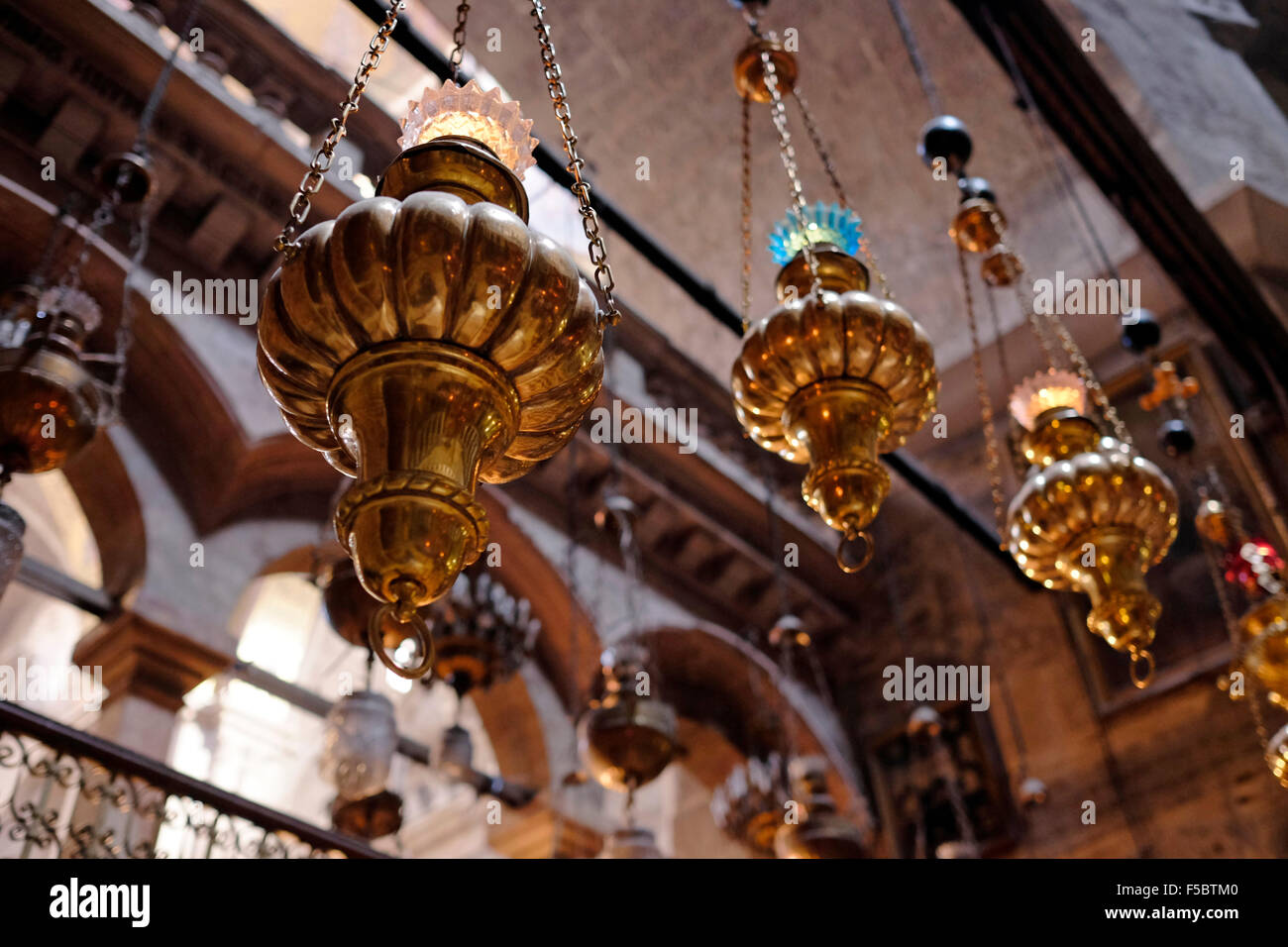 Lamps decorating the Dome of the Rotunda of the Church of the Holy Sepulchre in the the Old city East Jerusalem - Stock Image