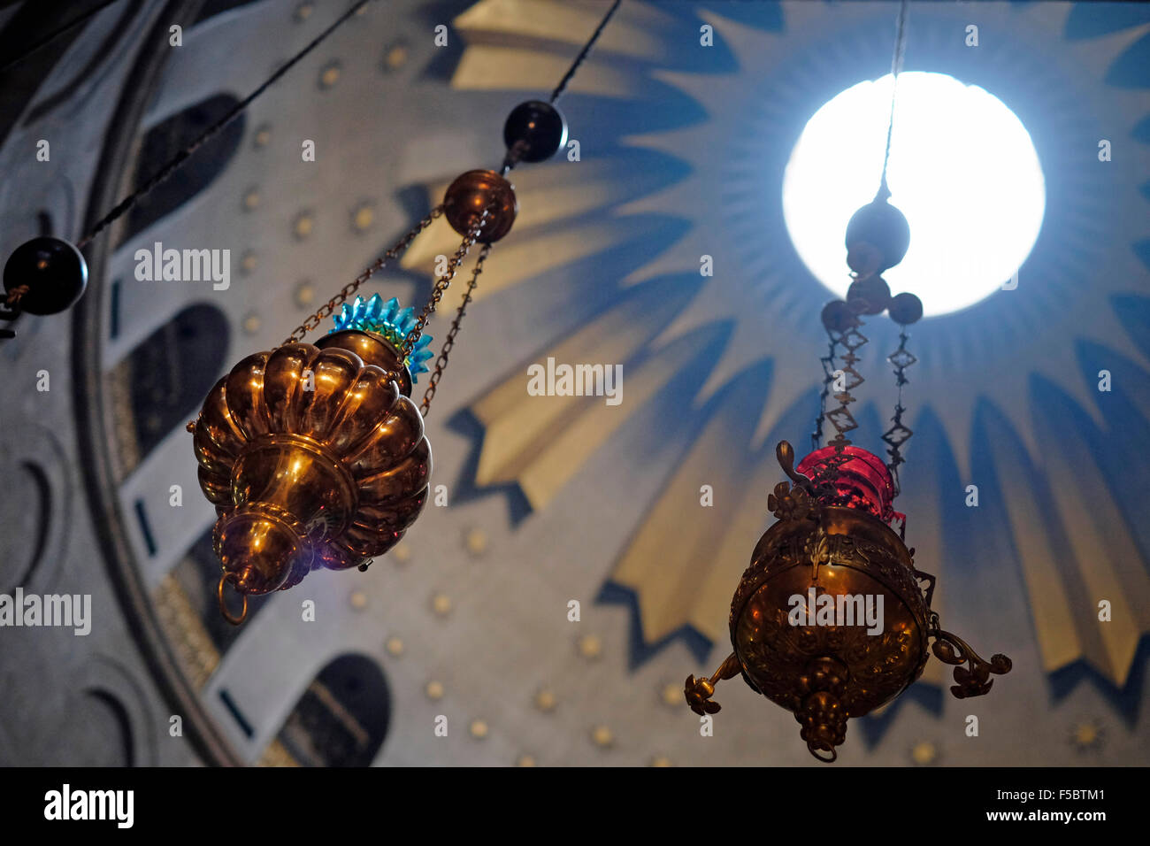 Lamps decorating the Dome of the Rotunda of the Church of the Holy Sepulchre in the Old city East Jerusalem Israel - Stock Image