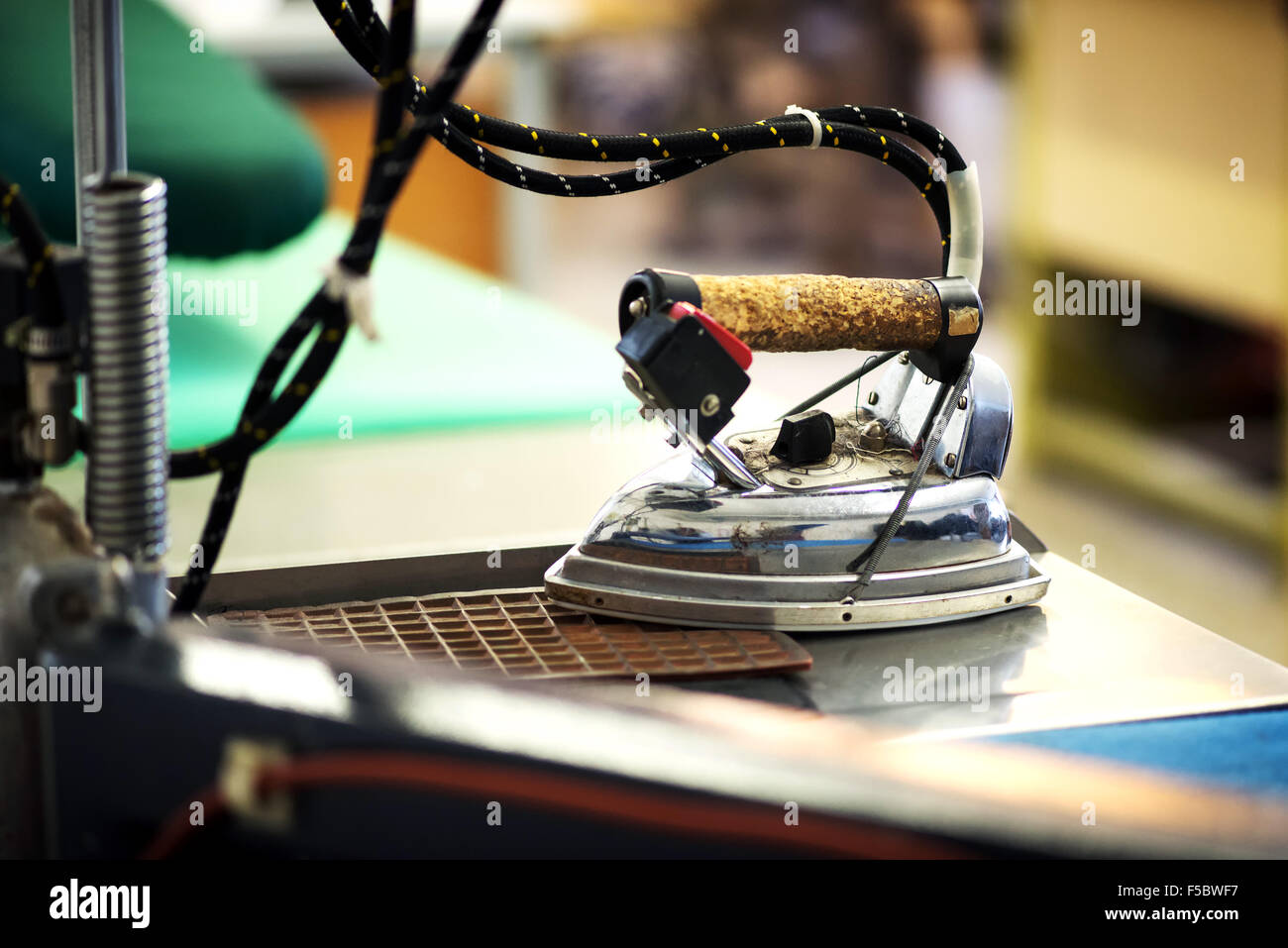 Professional iron in a tailor's factory, close up - Stock Image