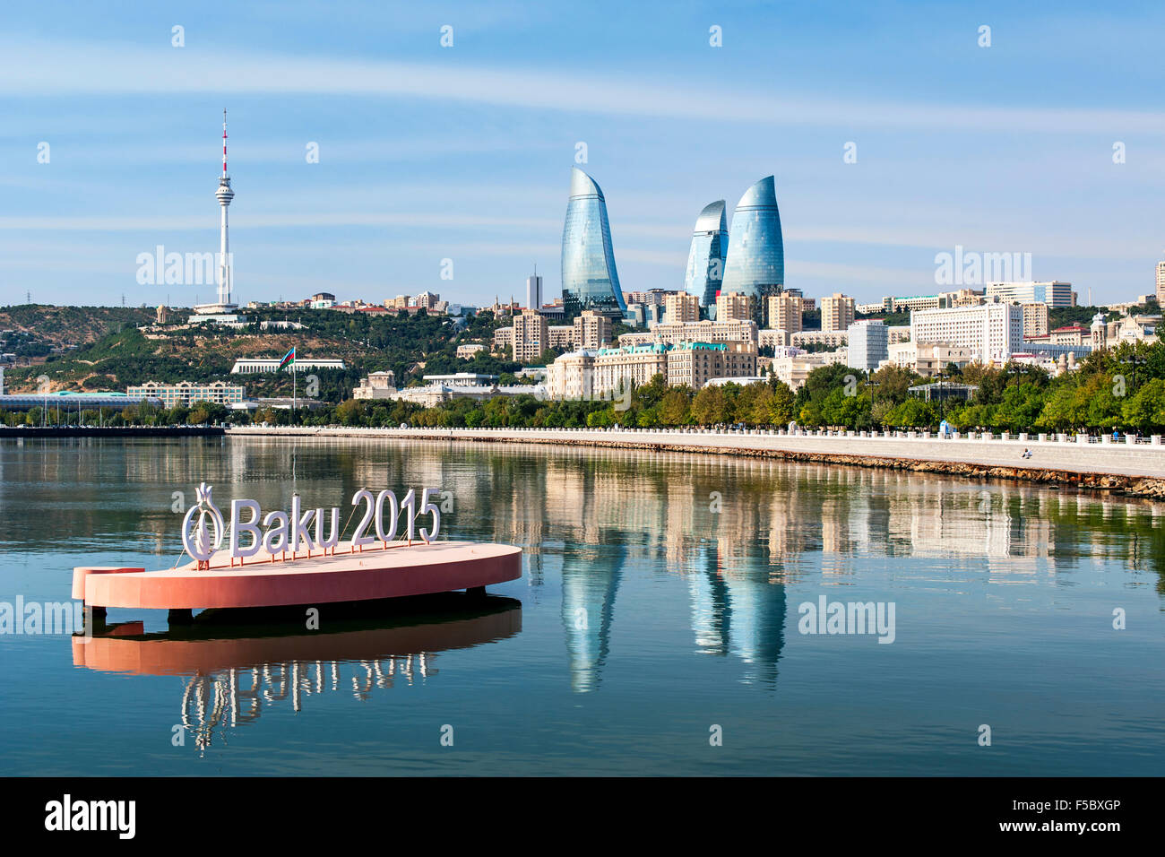 Baku Bay and the Baku skyline at dawn. The sign is to highlight the European games held in Baku in June 2015. - Stock Image