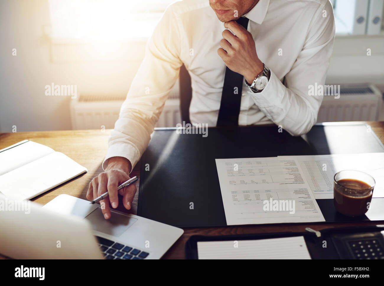 Business man working at office with laptop and documents on his desk, consultant lawyer concept - Stock Image