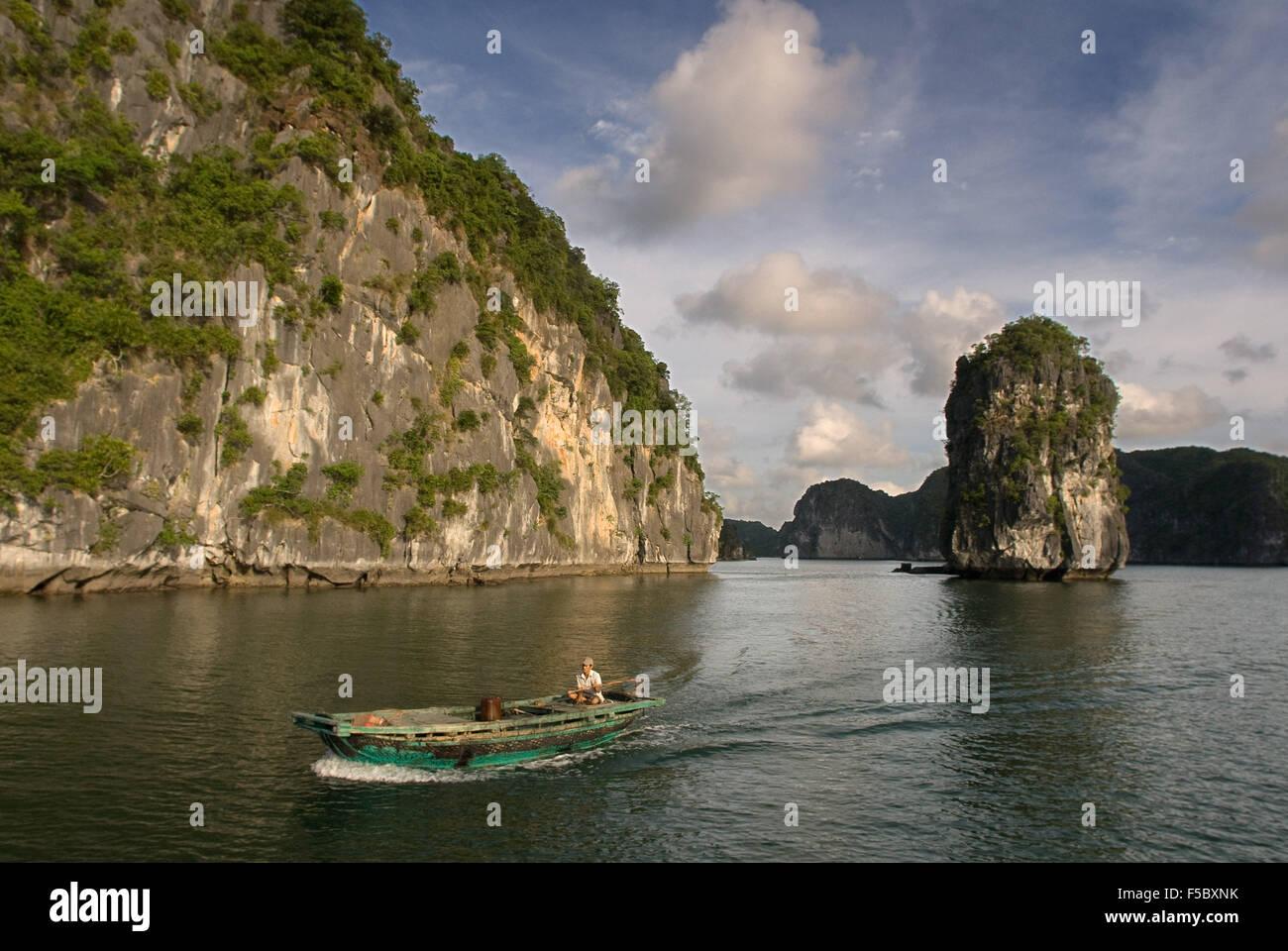 Boat and limestone karst in Ha long,Halong Bay, Vietnam,Ha long,Halong Bay, Vietnam - Stock Image