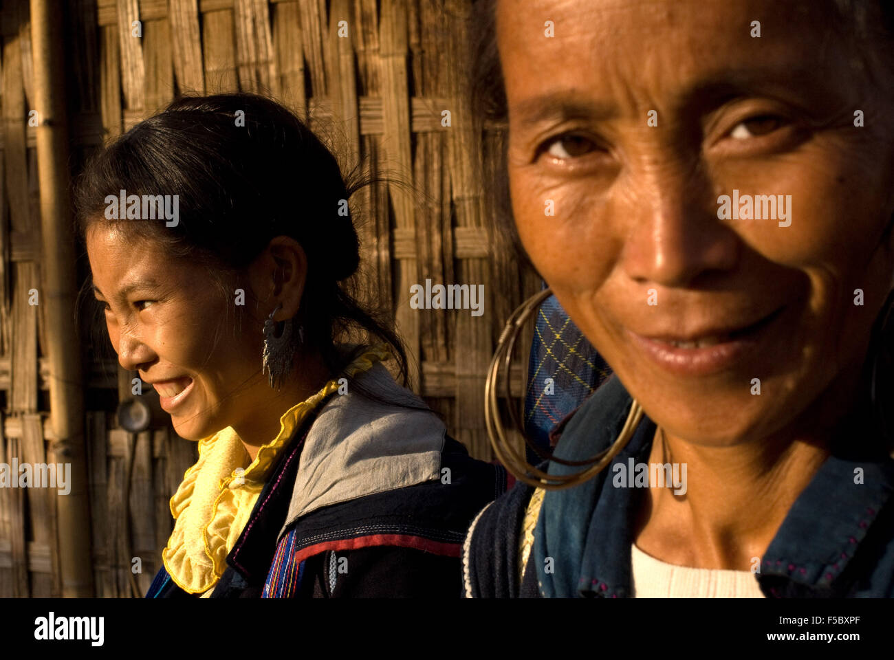 Some Hmong women in Sapa way to the nearby villages of Lao Chai and Ta Van. Vietnam. Trekking Sapa to Lao Chai. - Stock Image