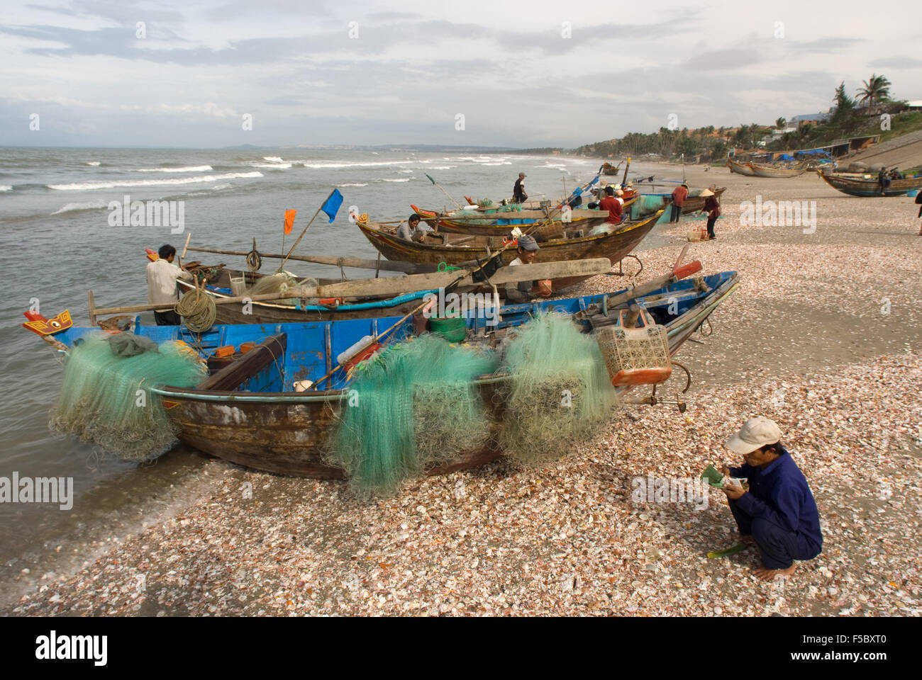 Fishermen in Mui Ne Beach, Vietnam. Fishing Catch. fishing village, Bình Thuận Province, Vietnam. - Stock Image