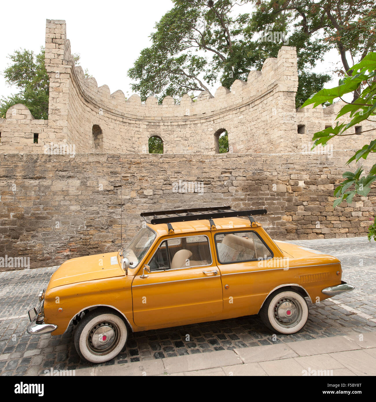 Old car parked on a street in İcheri Sheher, the old town in Baku, the capital of Azerbaijan. - Stock Image
