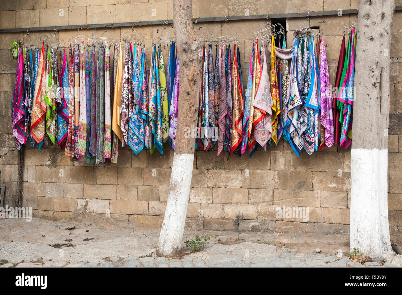 Colourful scarves hanging in the Old Town (İcheri Sheher) in Baku, capital of Azerbaijan. - Stock Image