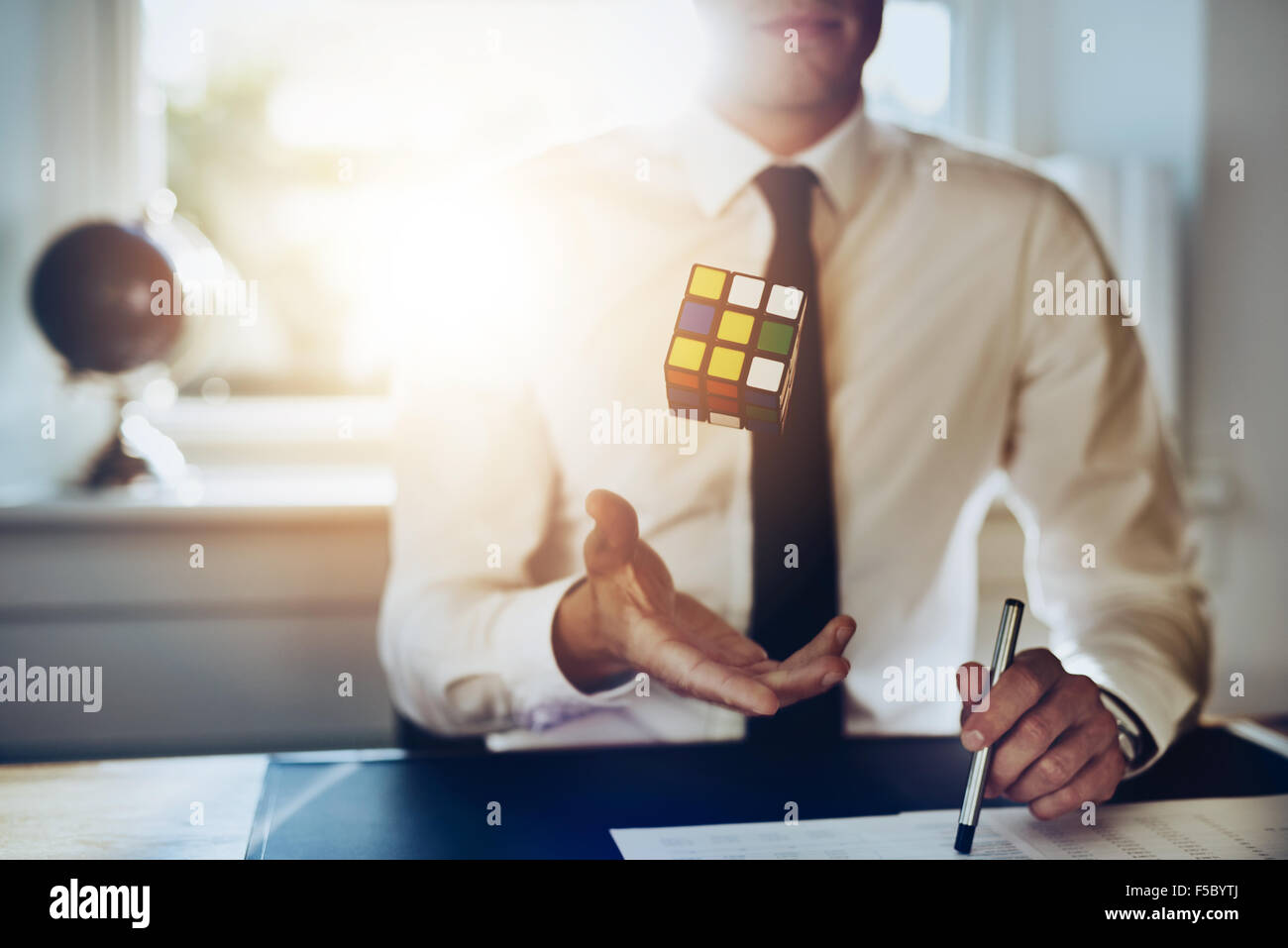 Confident successful business ma concept sitting at desk getting ideas, close up - Stock Image