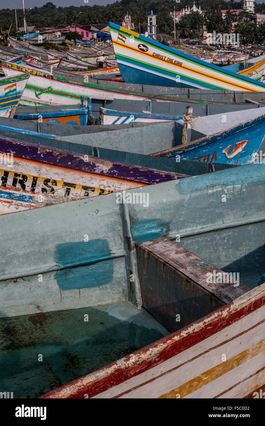 Vizhinjam Christian fisherman village in Kerala, India, November 2014. 'Christ is the King' fish boats. - Stock Image