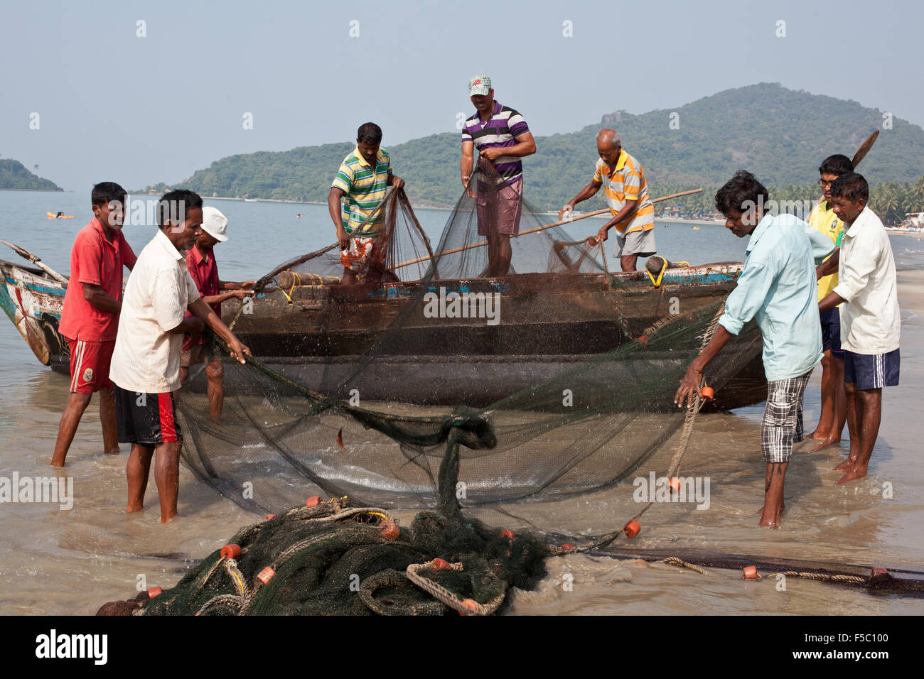 Vizhinjam Christian fisherman village in Kerala, India, November 2014. Fishing with the nets. - Stock Image