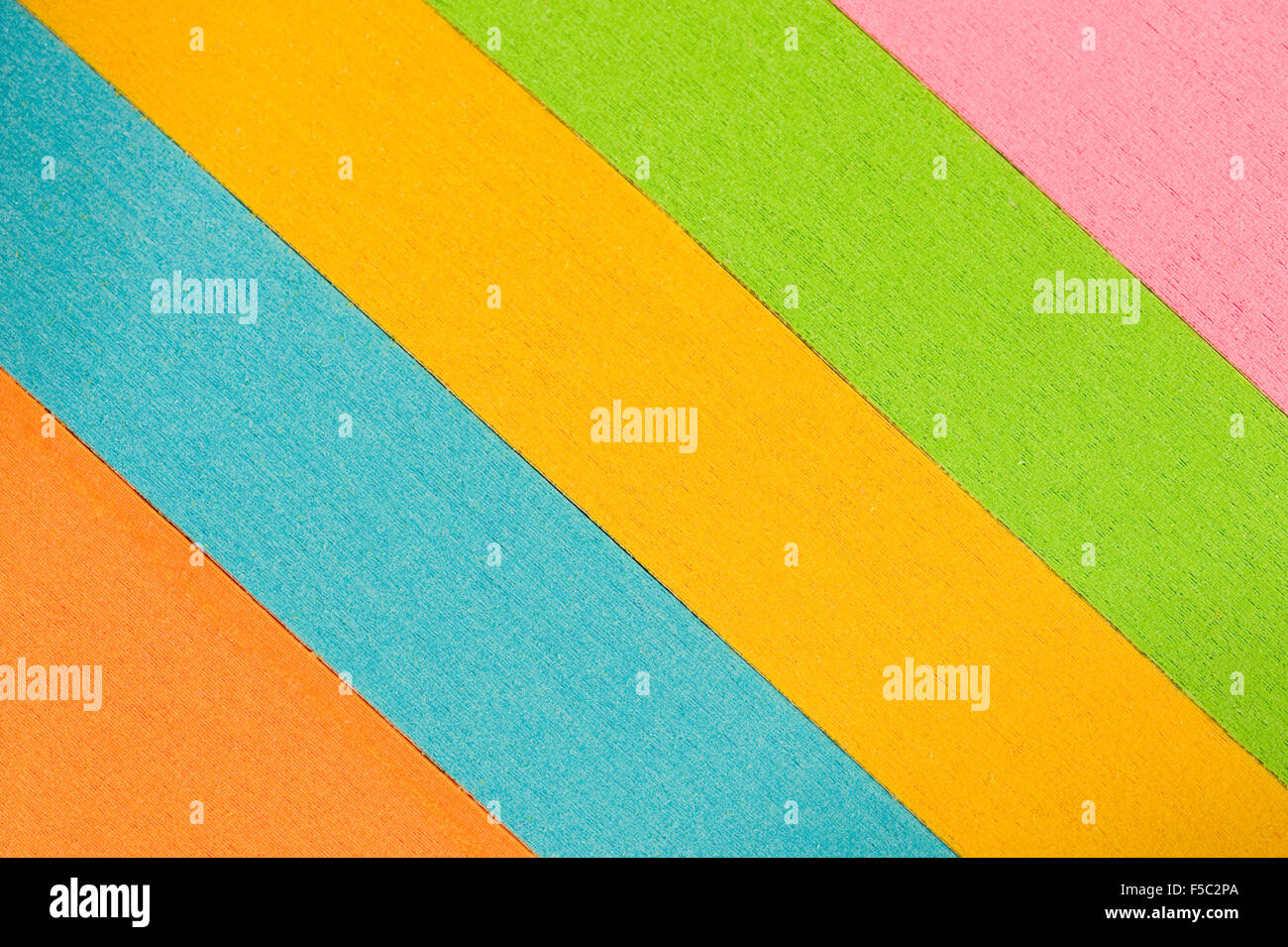 Slanted Multi-colored Stacks of Paper Background - Stock Image