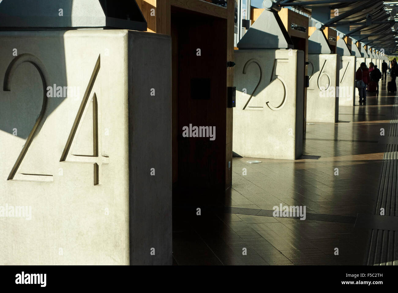 Numbered bus terminals entrances in Nils Ericson bas station in Göthenburg, Sweden - Stock Image