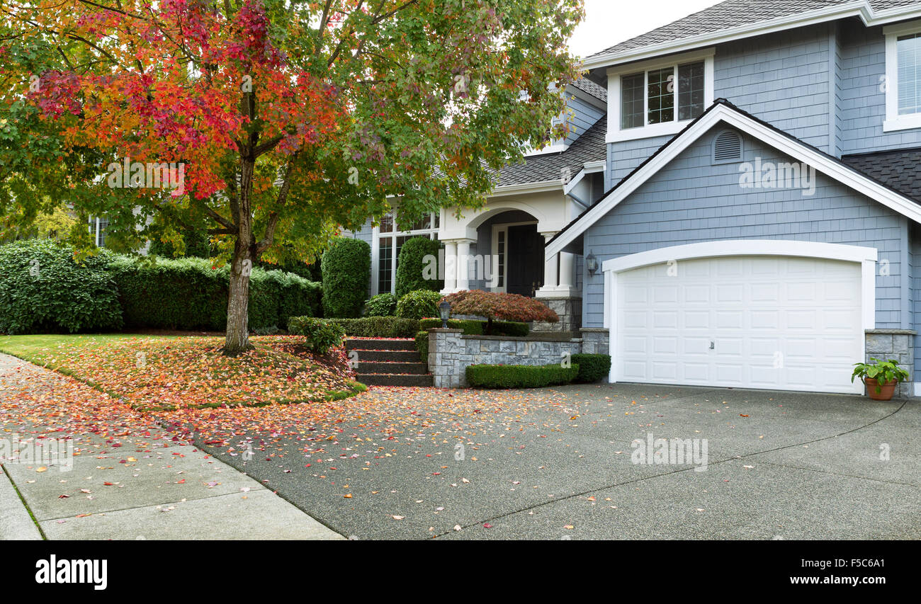 Detached house USA - large single family modern USA house with trees and lawn in Autumn season Stock Photo