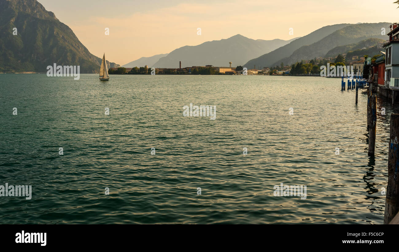 In the picture a view of Lake Iseo from the city of Lovere, on the side left of a sailboat. - Stock Image