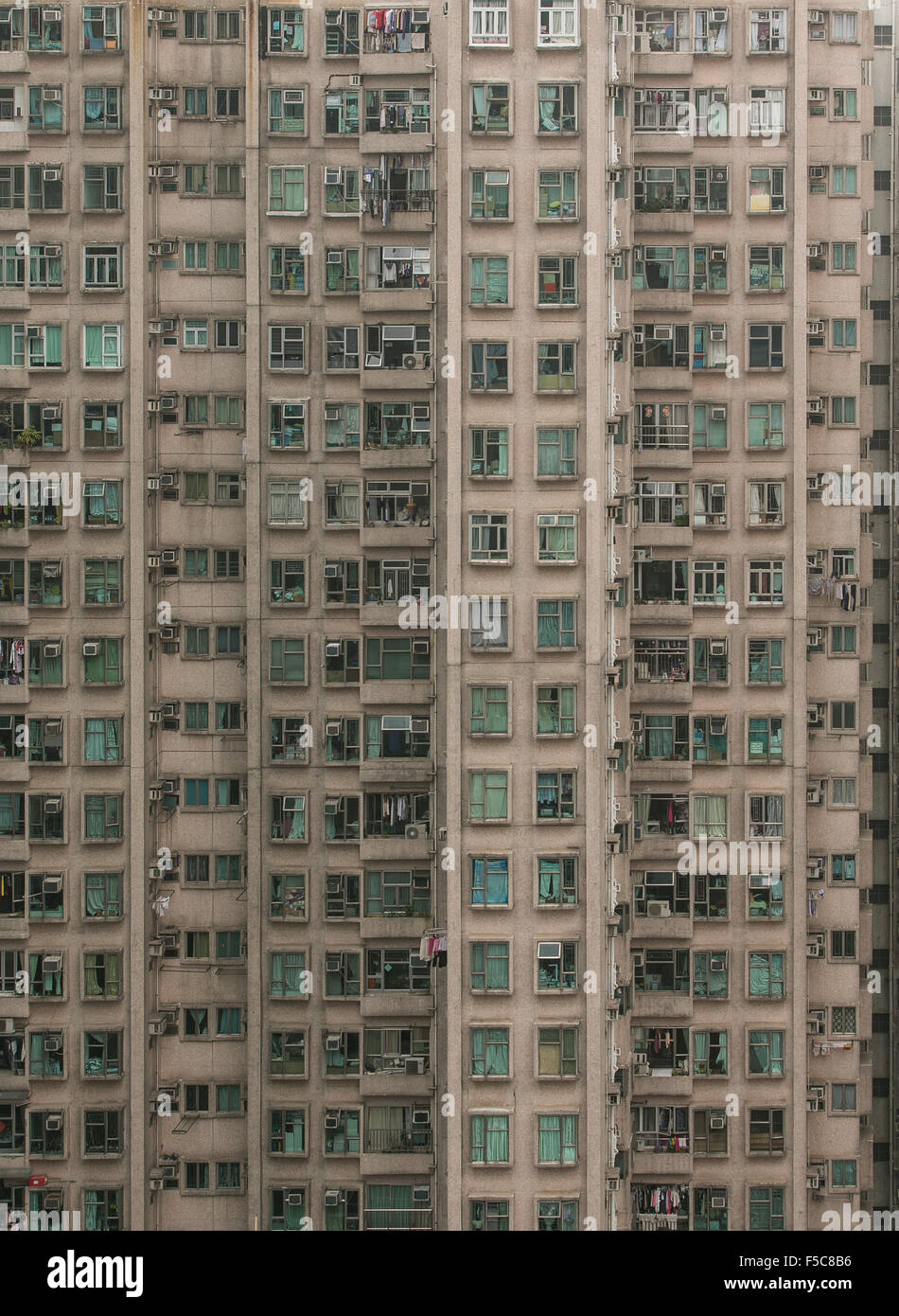 A residential building in Hong Kong that shows the tight living conditions in an extremely dense city. - Stock Image