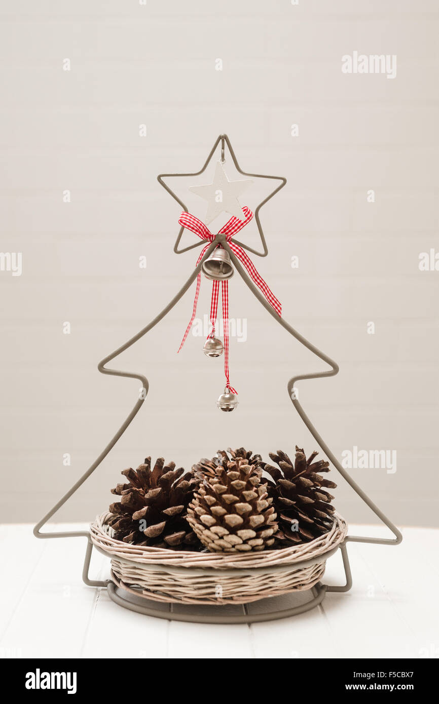 christmas decorative basket with pine cones - Stock Image