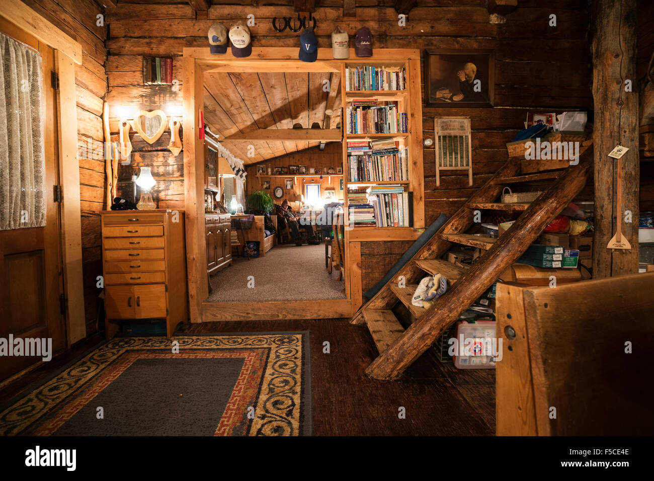 Interior of a cozy log cabin on the Gunflint Trail in northern Minnesota, USA - Stock Image