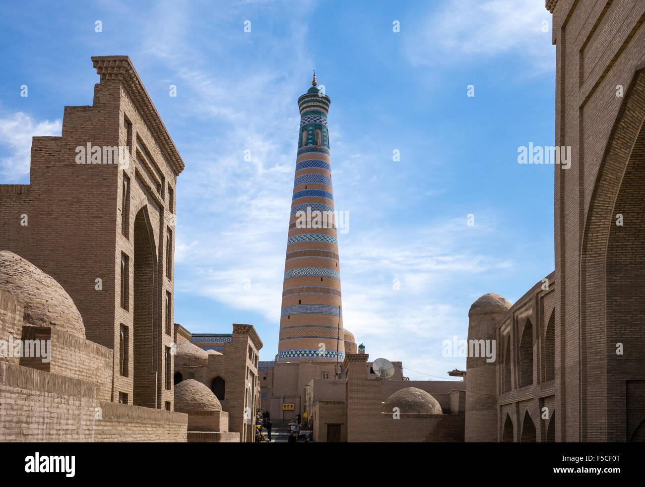 Uzbekistan, Khiva, the Islam Kodija minaret in the old city center - Stock Image