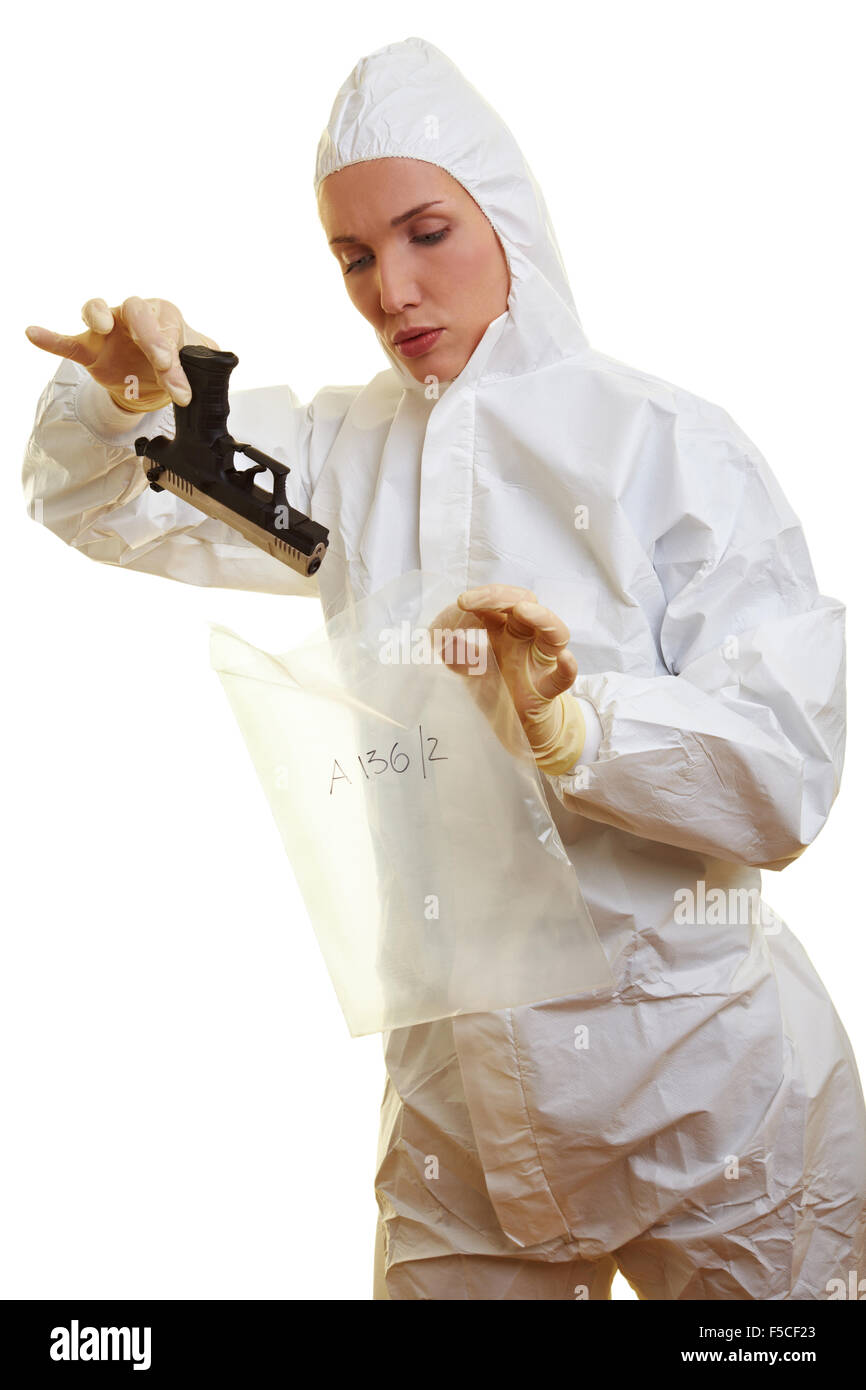 Female forensic scientist holding a weapon as evidence - Stock Image