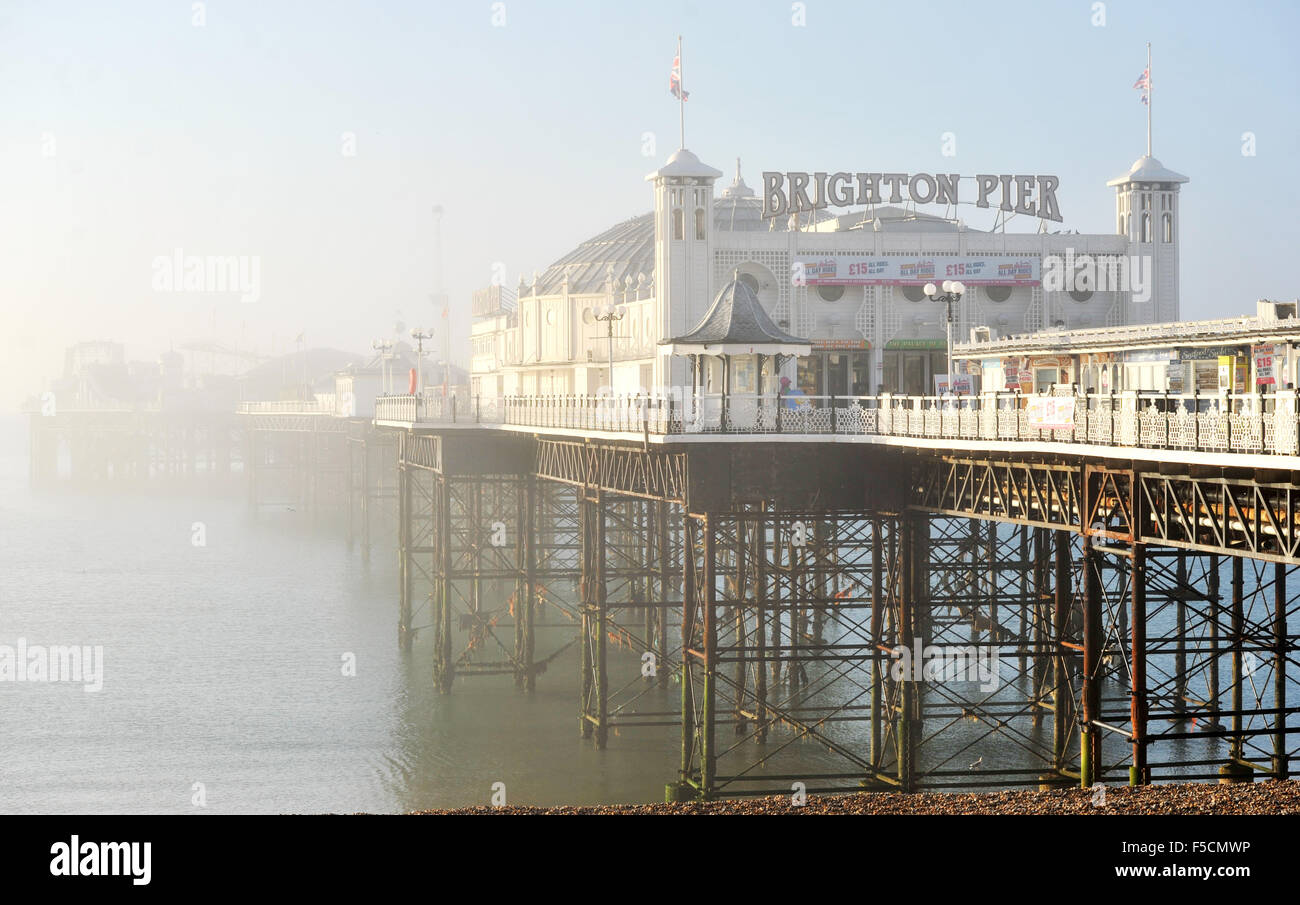 Brighton Sussex UK Monday 2nd November 2015 - Brighton Pier (formerly known as Palace Pier) is shrouded in fog early - Stock Image