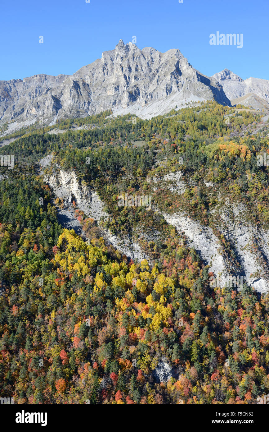 FALL FOLIAGE AT THE MERCANTOUR ALPS' FOOTHILLS (aerial view). Aiguille de Pelens (elevation 2523m), Alpes-Maritimes, - Stock Image
