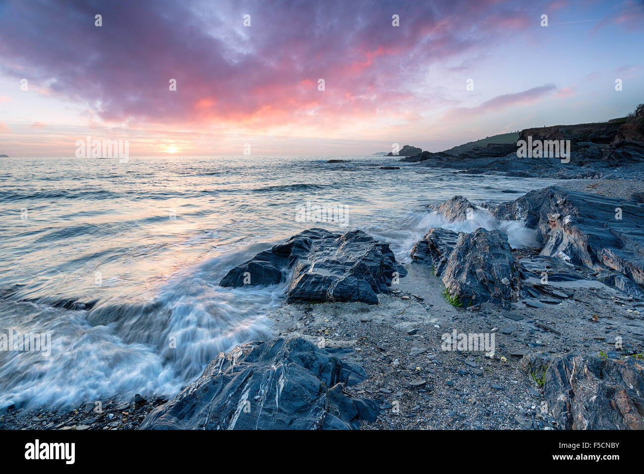 Stunning sunset over the rocky beach at Trevone Bay near Padstow in Cornwall - Stock Image