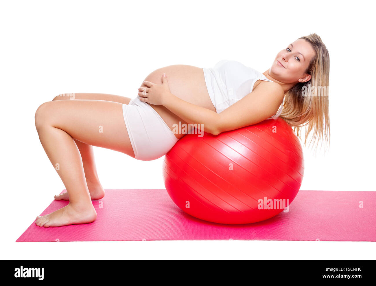 Working out with fitness ball during pregnancy - Stock Image