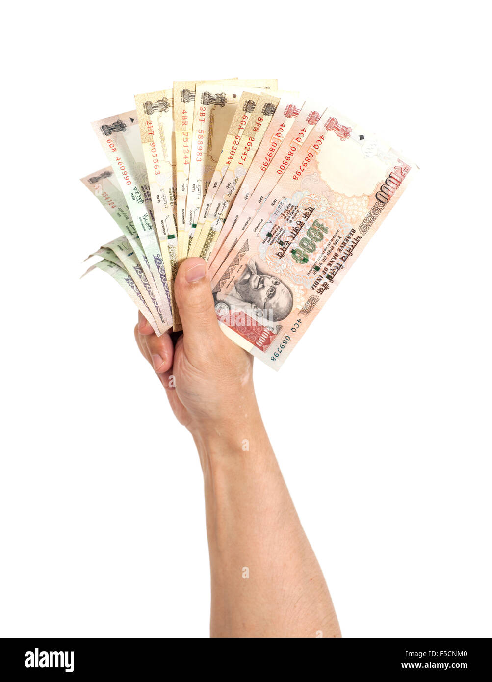 Hand with Indian thousand rupee notes isolated - Stock Image