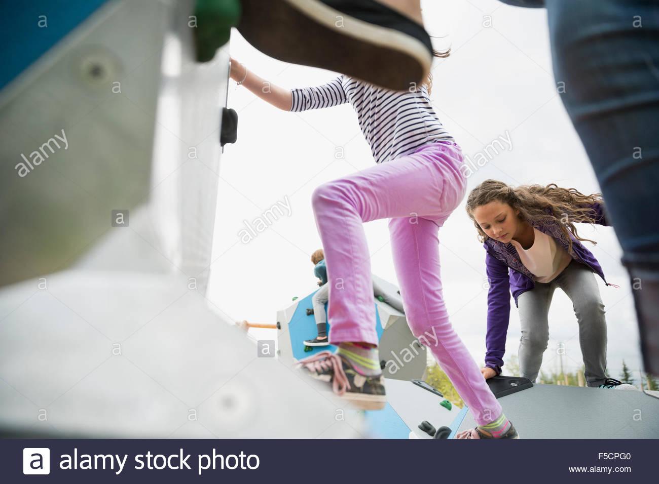 Kids climbing geometric shapes at playground - Stock Image
