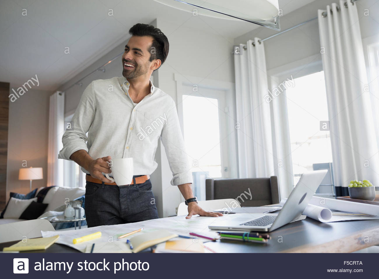 Table blueprint stock photos table blueprint stock images alamy smiling architect with blueprints drinking coffee dining table stock image malvernweather Choice Image