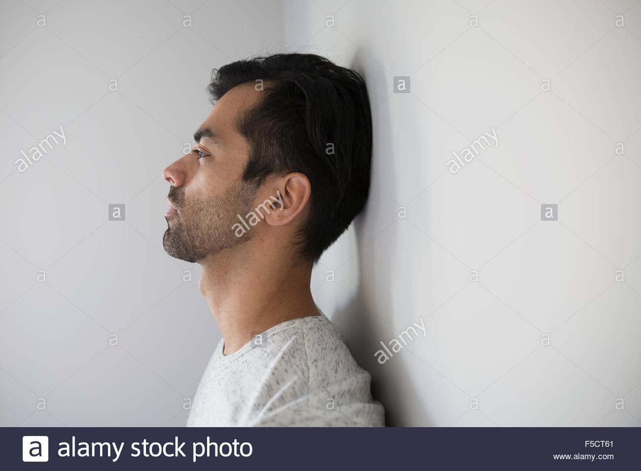 Profile of pensive man looking away - Stock Image