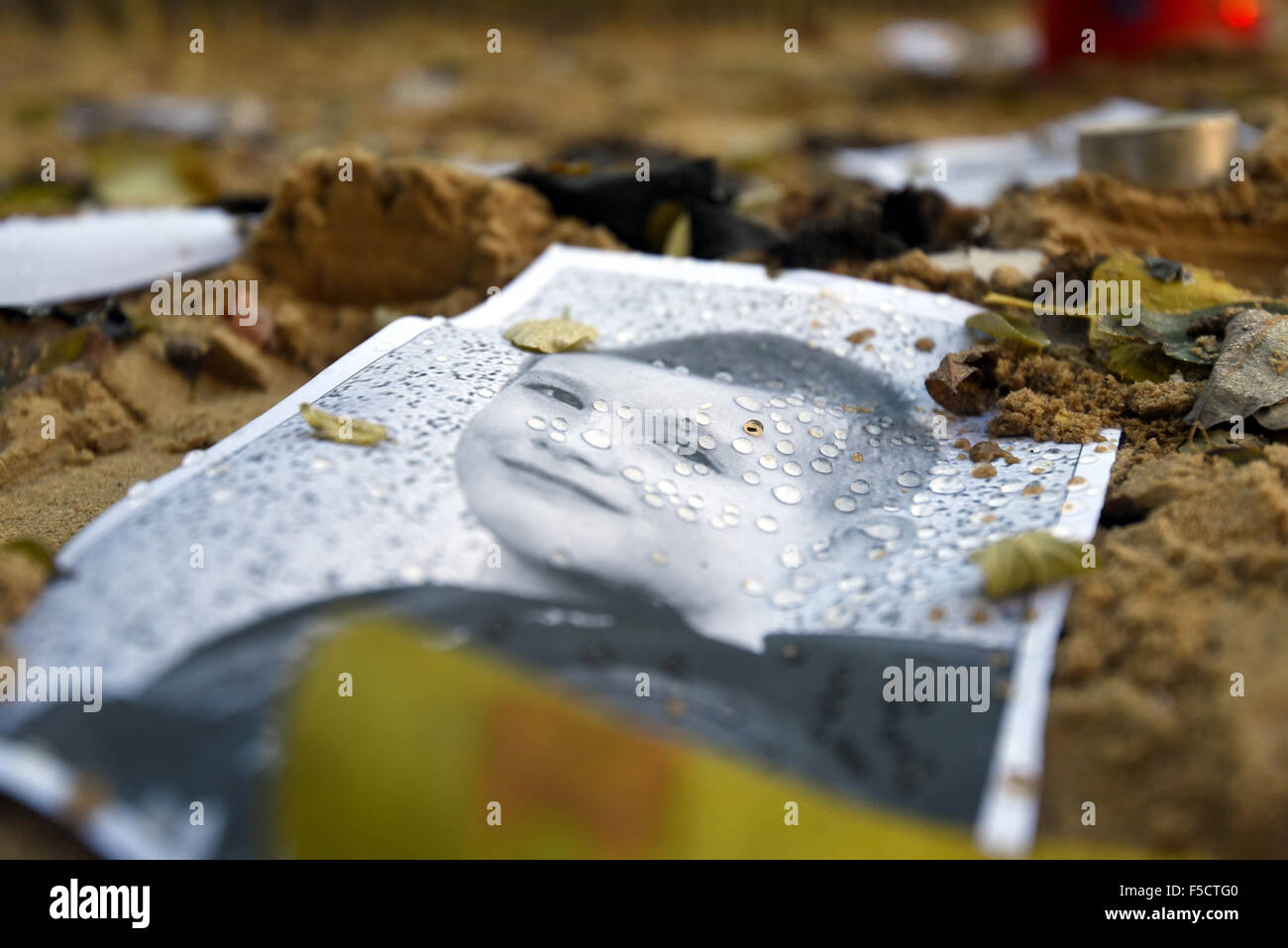 Potsdam, Germany. 02nd Nov, 2015. Pictures of Elias, deceased, have been placed in a sandbox at the 'Am Schlaatz' - Stock Image