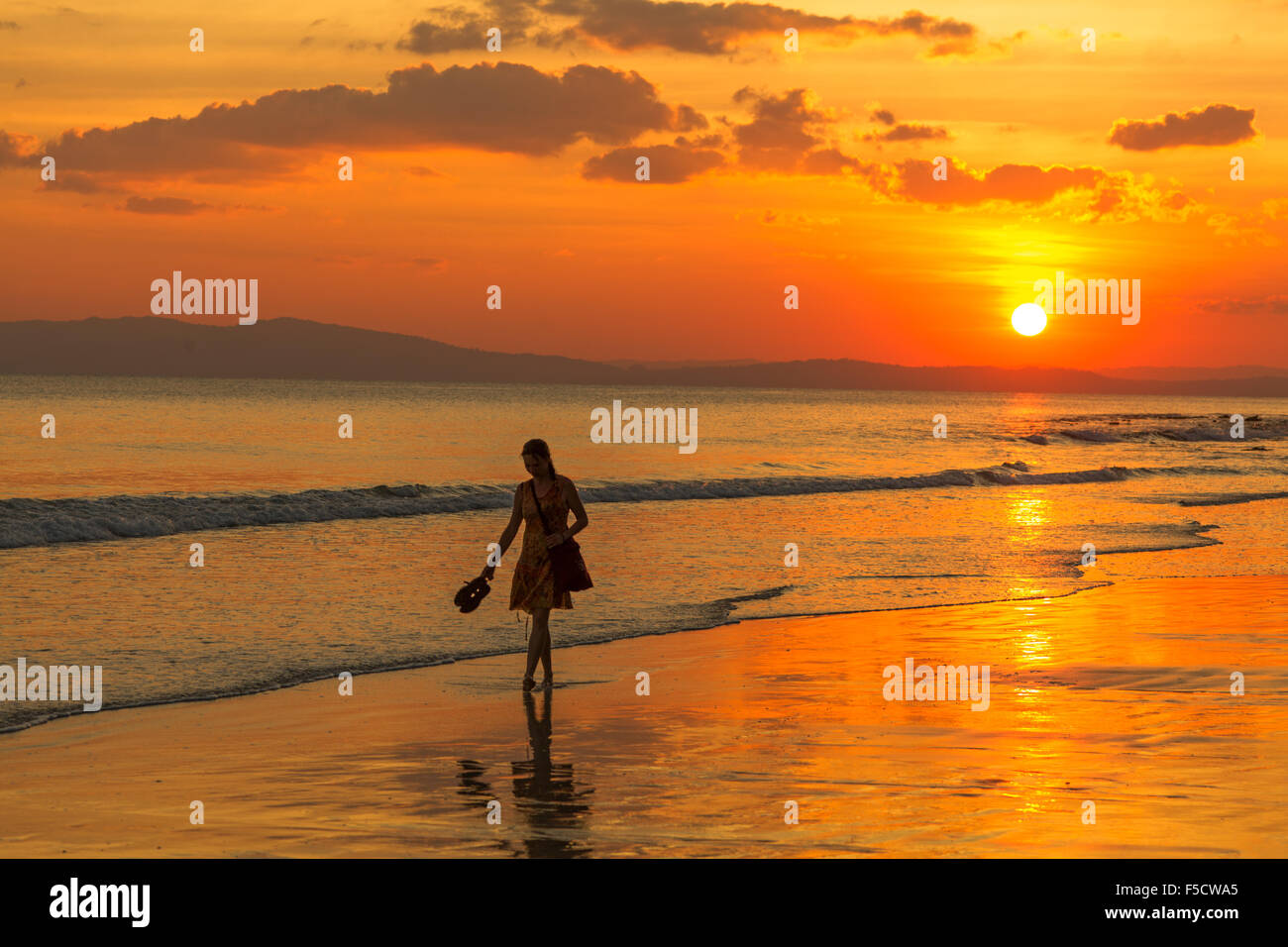 Young woman at sunset on Radhnagar Beach, one of the most beautiful beaches of the world - Stock Image